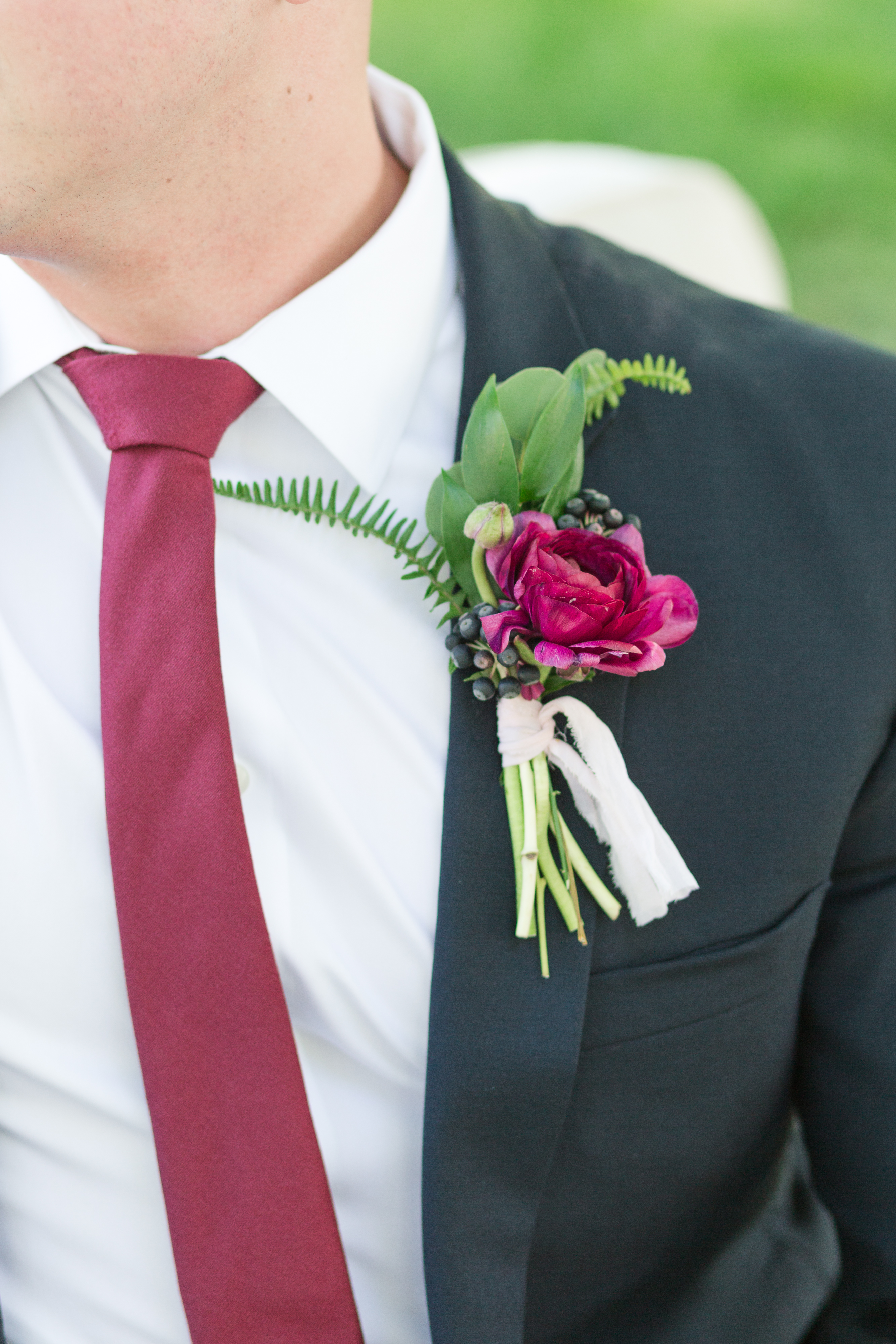 Raleigh wedding planner, Services, Jamie Blow Photography, Downtown Raleigh Wedding, groom with burgundy flower
