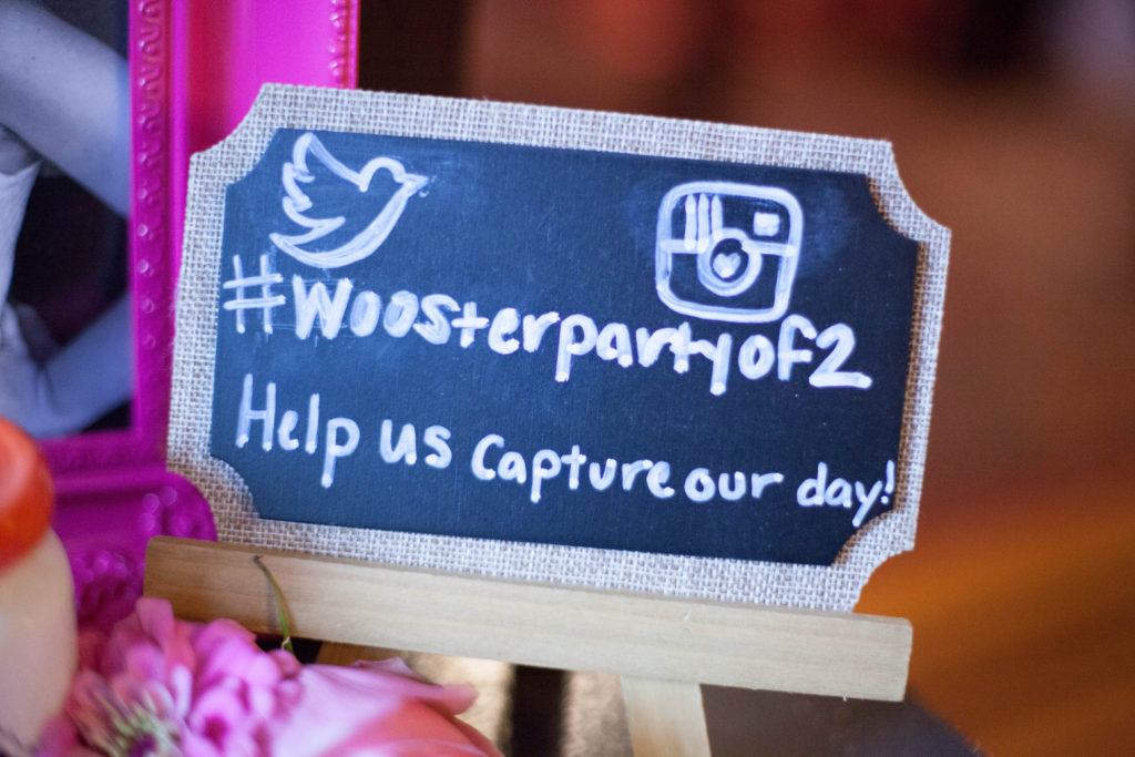 twitter and instagram logos with the wedding day hashtag on chalkboard sign