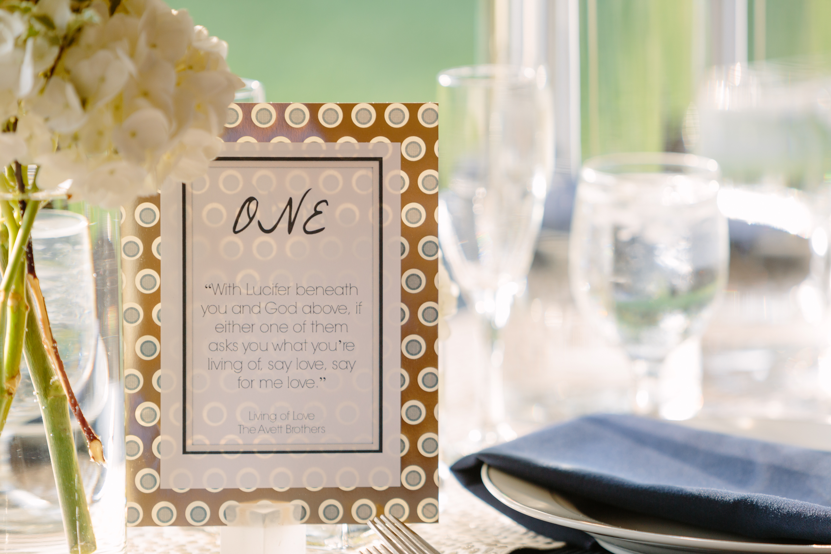 custom made table numbers with avett brothers song titles quotes white hydrangea and navy linen napkins