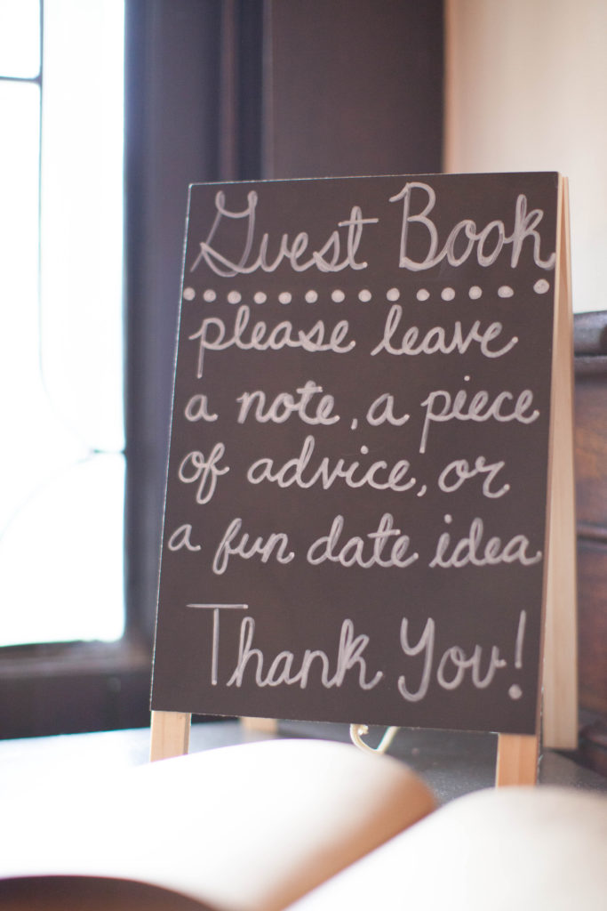 guestbook sign on chalkboard please leave a note, piece of advice, or a fun date idea