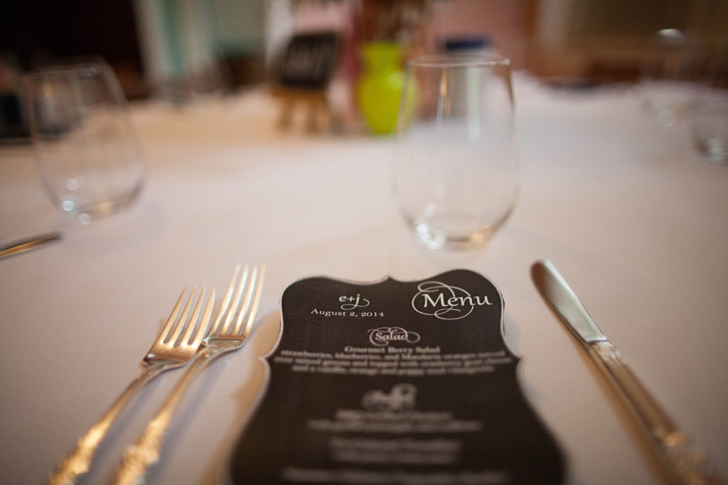close up of menu cards on white cotton linen at the Tucker House in downtown Raleigh