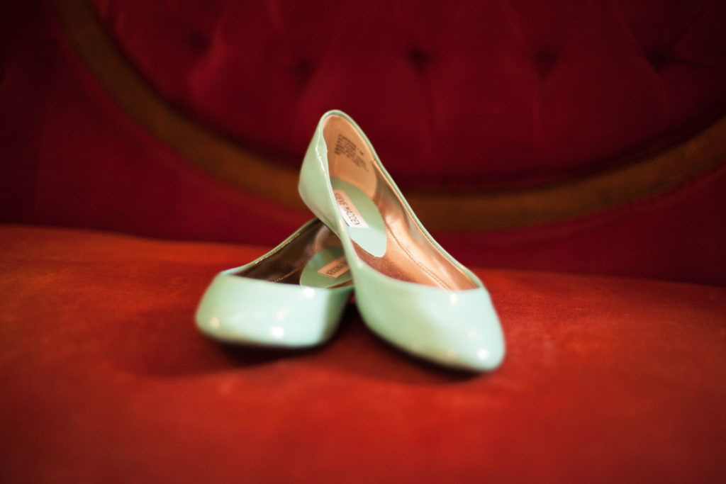 flat something blue shoes resting on red couch at The Tucker House in downtown Raleigh