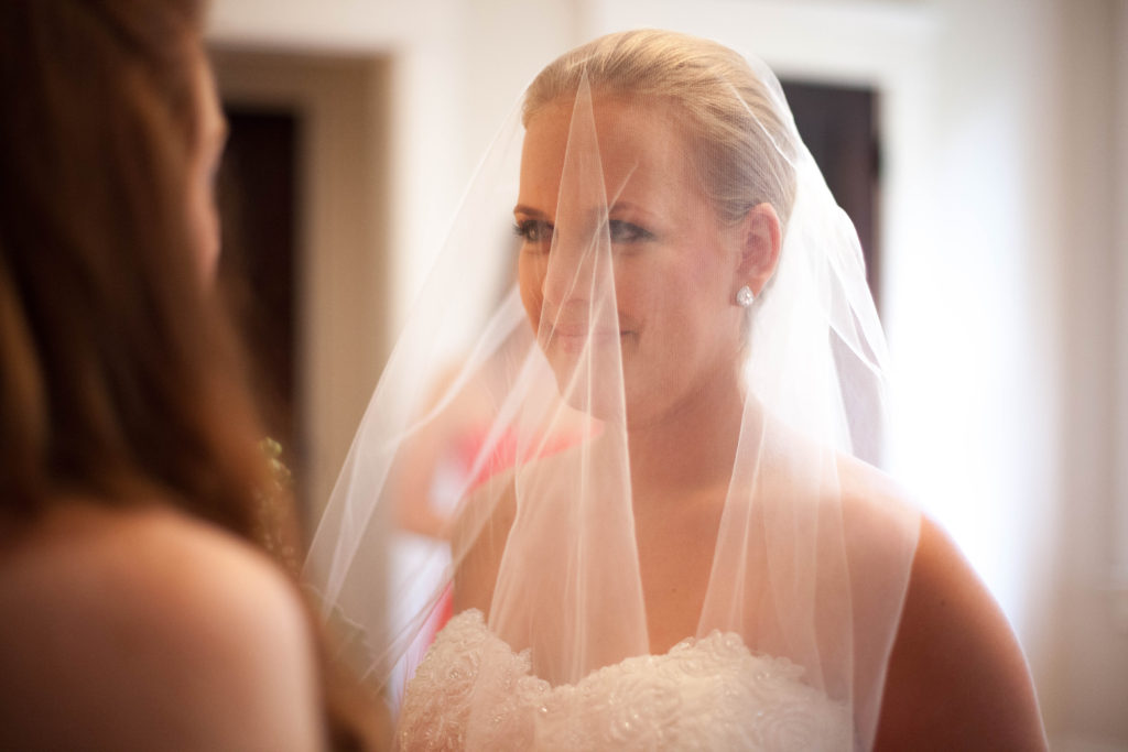 veil being put over the brides face