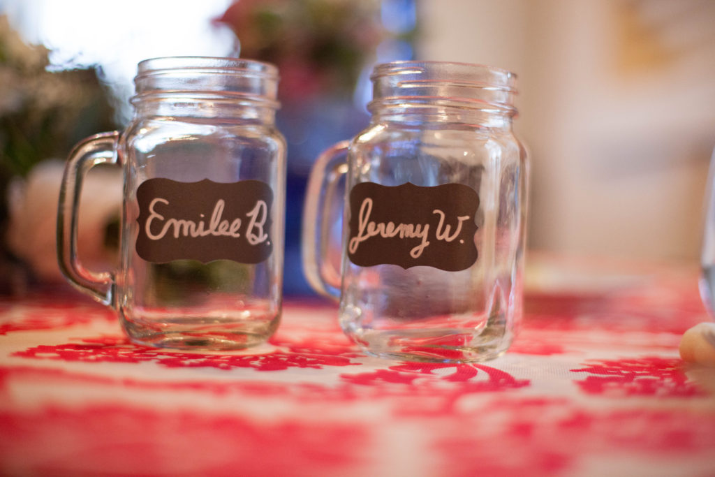 clear mason jars with handles and chalk board labels used as escort cards