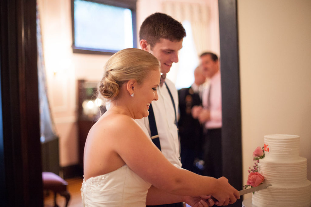 bride and groom cutting the cake by Cinda's Creative Cakes at The Tucker House in downtown Raleigh