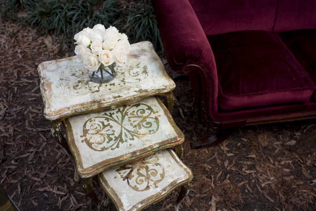 vintage nesting tables in white and gold with white roses photo by Nieto Photography
