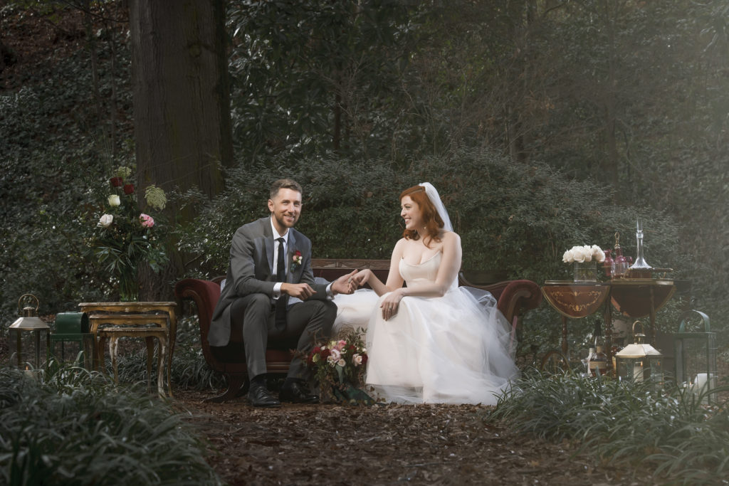 redhead bride and groom on vintage couch lounge area from The Prettiest Pieces photo by Nieto Photography