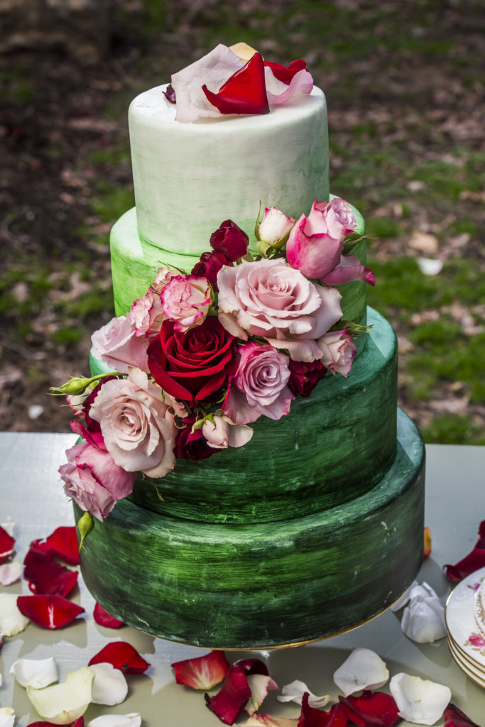 green tiered wedding cake with roses photo by Nieto Photography