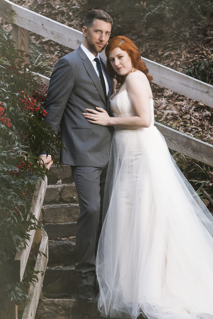 bride and groom in the raleigh rose garden photo by Nieto Photography