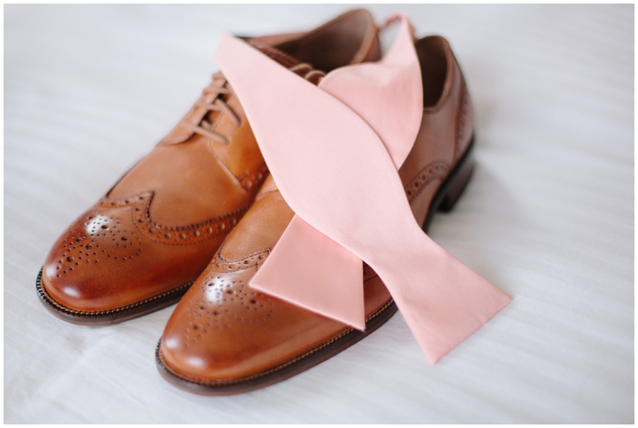 groom's accessories- pink bowtie and brown shoes