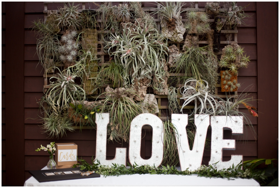 marquee love sign at wedding