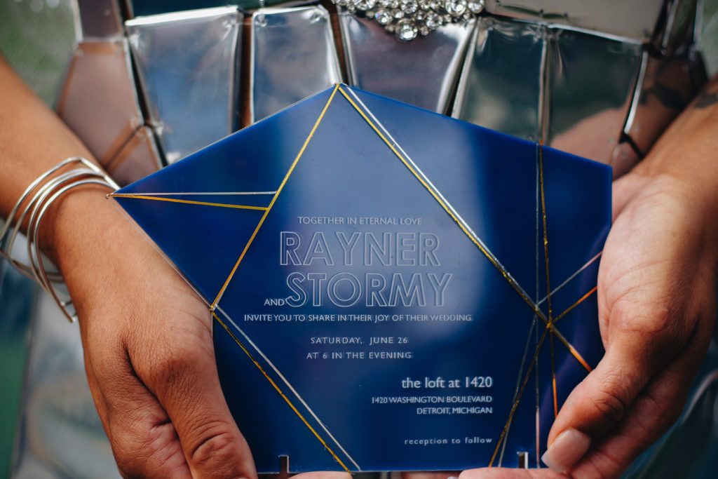 human holding tile invitation, wedding invitation on acrylic