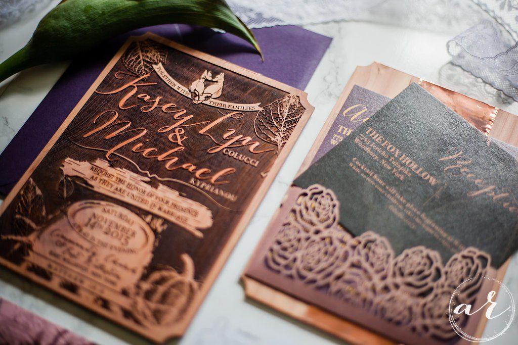 wedding invitation on wood